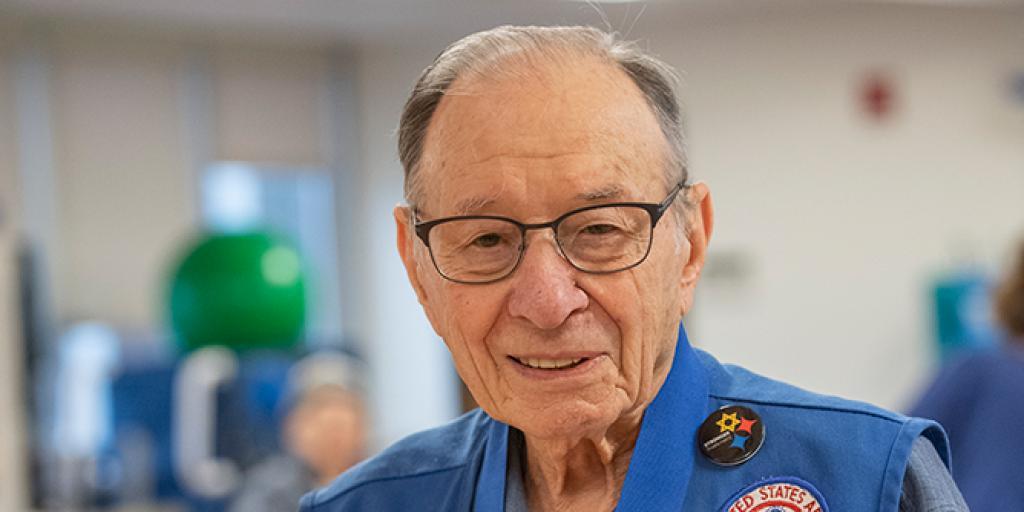 Veteran posing with his medallion