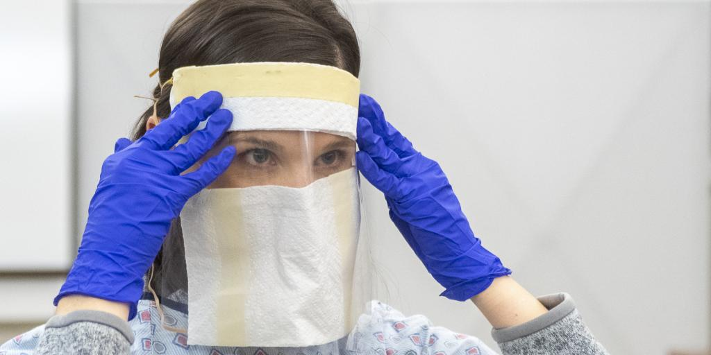 Nurse with face mask.