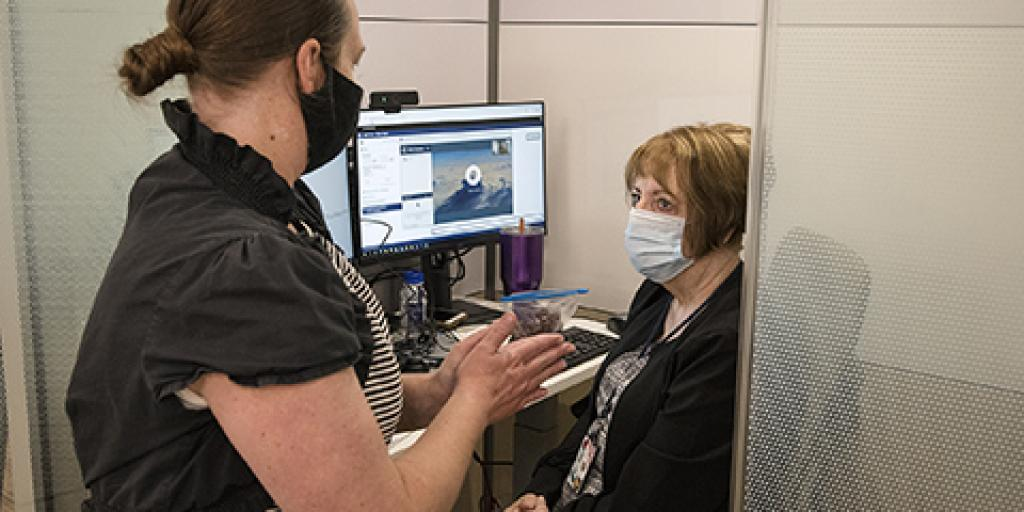 A VA Salt Lake City Health Care System TeleMental Health Program Coordinator instructs a provider on how to connect with Veterans using a video conferencing program.