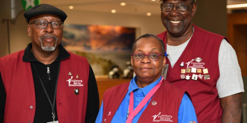 Volunteers at Ralph H. Johnson VA Medical Center wear red vests to signify themselves as NaVAgators who help Veterans find their way to appointments throughout the hospital. (Photo by James Arrowood)
