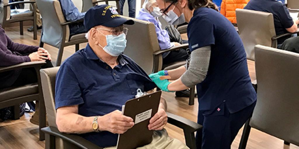 98-year-old WWII Veteran John Dempsey receives with COVID-19 vaccination at the North Charleston VA Outpatient Clinic on Feb. 1, 2021.