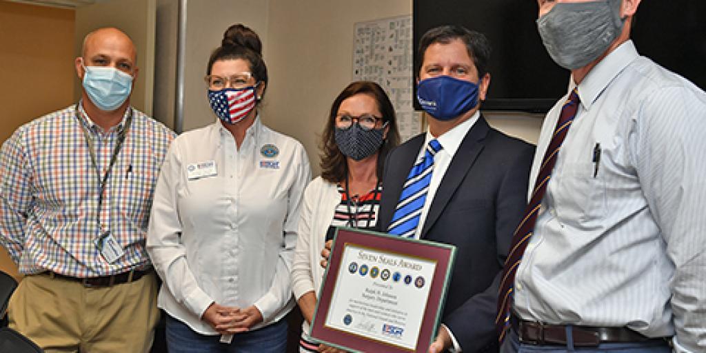 Members from the Charleston VA and ESGR present Seven Seals Award
