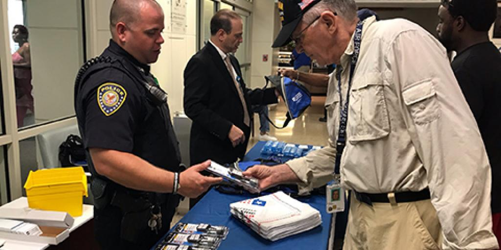 A Veteran receives a free gun lock from a VA Police Officer during a Suicide Prevention Awareness event at Charleston VAMC on Sept. 9, 2019. Photo by Erin Curran.