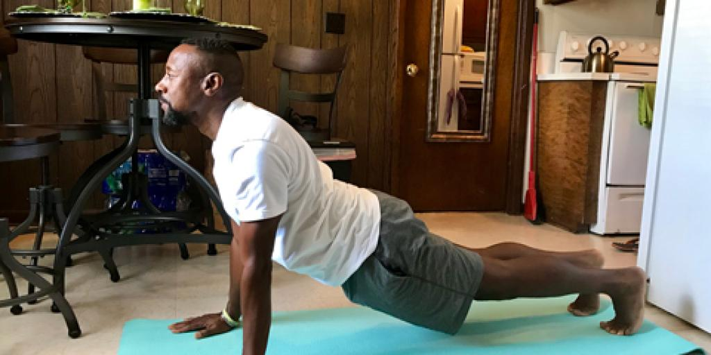 U.S. Army Veteran Darryl Gadsden practices yoga as part of his alternative therapy treatments for pain management. (Photo by Erin Curran)