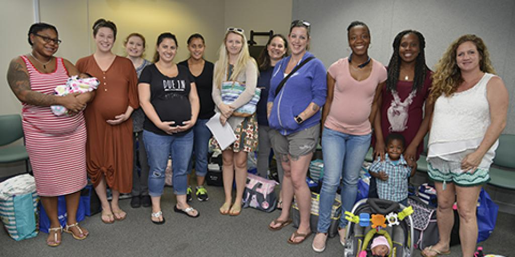 Eleven new and expecting Veteran mothers attended the Trident VA Clinic's Baby Shower on May 9. Photo by James Arrowood.