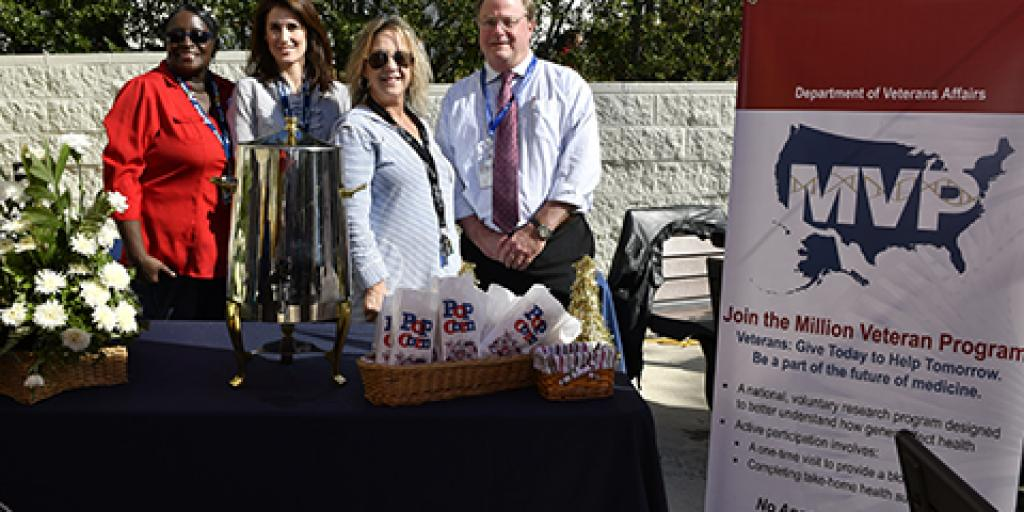 (From Left to Right) Teresa Mitchell, Courtney Harrington, Dana Rosson and Mark Hamner, MD, hand out free popcorn and lemonade to staff and visitors to celebrate their latest Million Veteran Program milestone. Photo by Scott Pauley.
