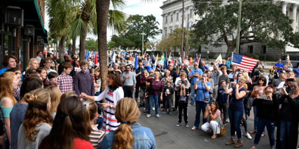 A crowd watches the choir from Laing Middle School sing the National Anthem at the 2018 Charleston Veterans Day Parade. The Ralph H. Johnson VA Medical Center sponsored the annual event held on Nov. 4 this year.