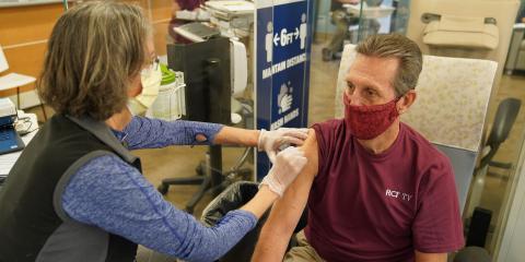 Maria Fruin vaccinates a Veteran
