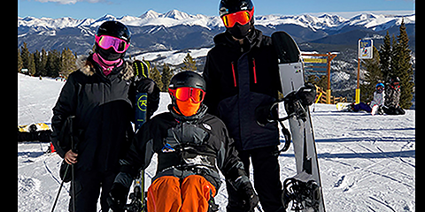 Army Veteran Nathan Turner skiing in Breckenridge, CO with his wife and son. Turner learned to ski during the pandemic.