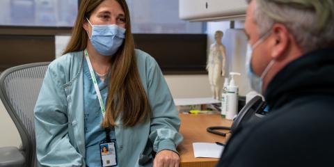 Air Force Veteran AJ Ethridge Jr talks with a VA doctor