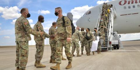 service members return home