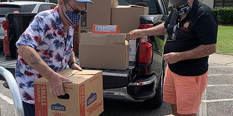 VFW Post 10804 and Country Lakes unloads a donation of more than 1,000 pounds of shelf-stable food for the Curbside Delivery Program for Veterans in Myrtle Beach, South Carolina.