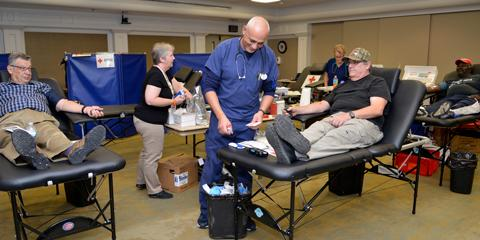 Charleston VAMC staff, Veterans and visitors donate blood at a recent Red Cross Blood drive held in the hospital's main auditorium. Photo by James Arrowood.