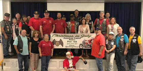 As part of the annual Christmas in July program, The American Legion Post 166 Riders donated clothing, personal care items, backpacks, hygiene items and shoes totaling more than $2,400.