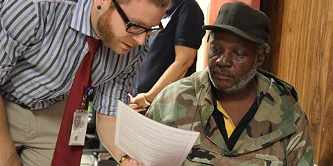 A VA employee assists a Veteran with applying for housing benefits during a past Stand Down event in Myrtle Beach, South Carolina. Photo by Meredith Hagen.
