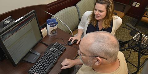 Charleston VAMC My HealtheVet Coordinator Heather Friesen assists a Veteran with his My HealtheVet enrollment. Photo by James Arrowood (2016).