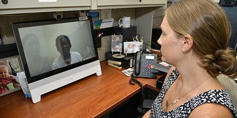 Ralph H. Johnson Doctor Providing Virtual Care to a Veteran