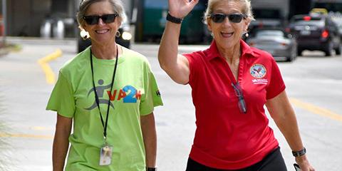 MOVE Coordinator Rebecca Luhrs, RN and Clinical Nurse Educator Jan Shriner, RN welcome other walkers during the VA2K. Photo by James Arrowood.