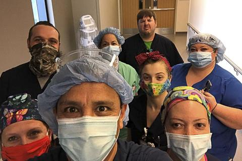 Respiratory therapist Eduardo Cardenas and other healthcare professionals wearing masks and working with COVID-19 patients.
