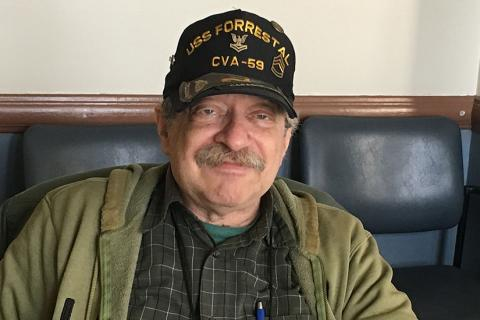 Picture of Denny Meyer wearing a Navy Veteran hat