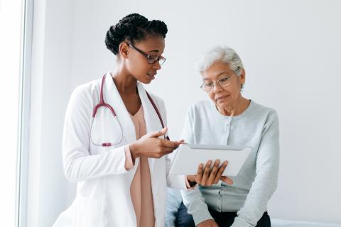 A doctor speaks to a patient