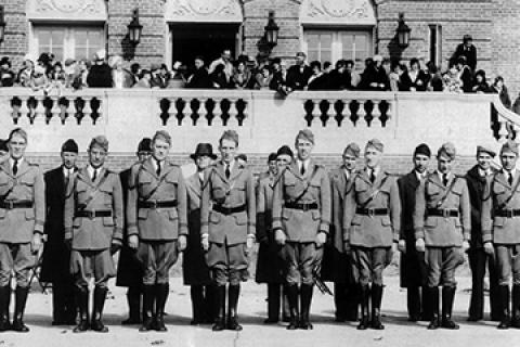 Veterans in uniform attend the dedication ceremony at the Coatesville VA Medical center on May 12, 1931 with other guests gathered on the front steps of building 1 behind them.