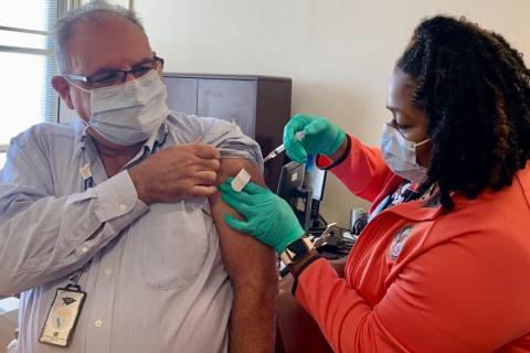 Medical Center Director receiving the flu shot