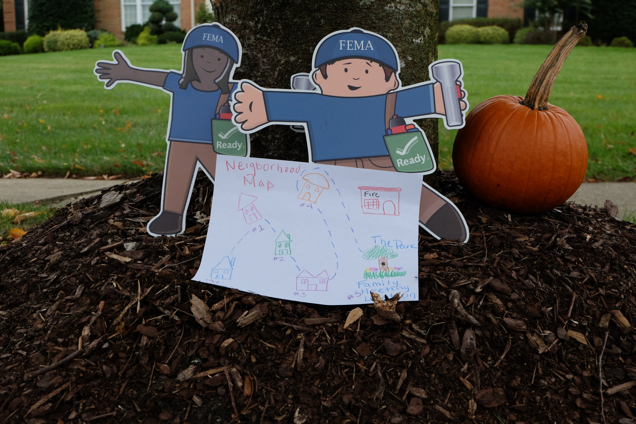 Washington, D.C., October 30, 2013 -- Flat Stanley and Flat Stella prepare to go trick-or-treating in their neighborhood by highlighting their path using a map of their neighborhood from their family emergency communication plan.