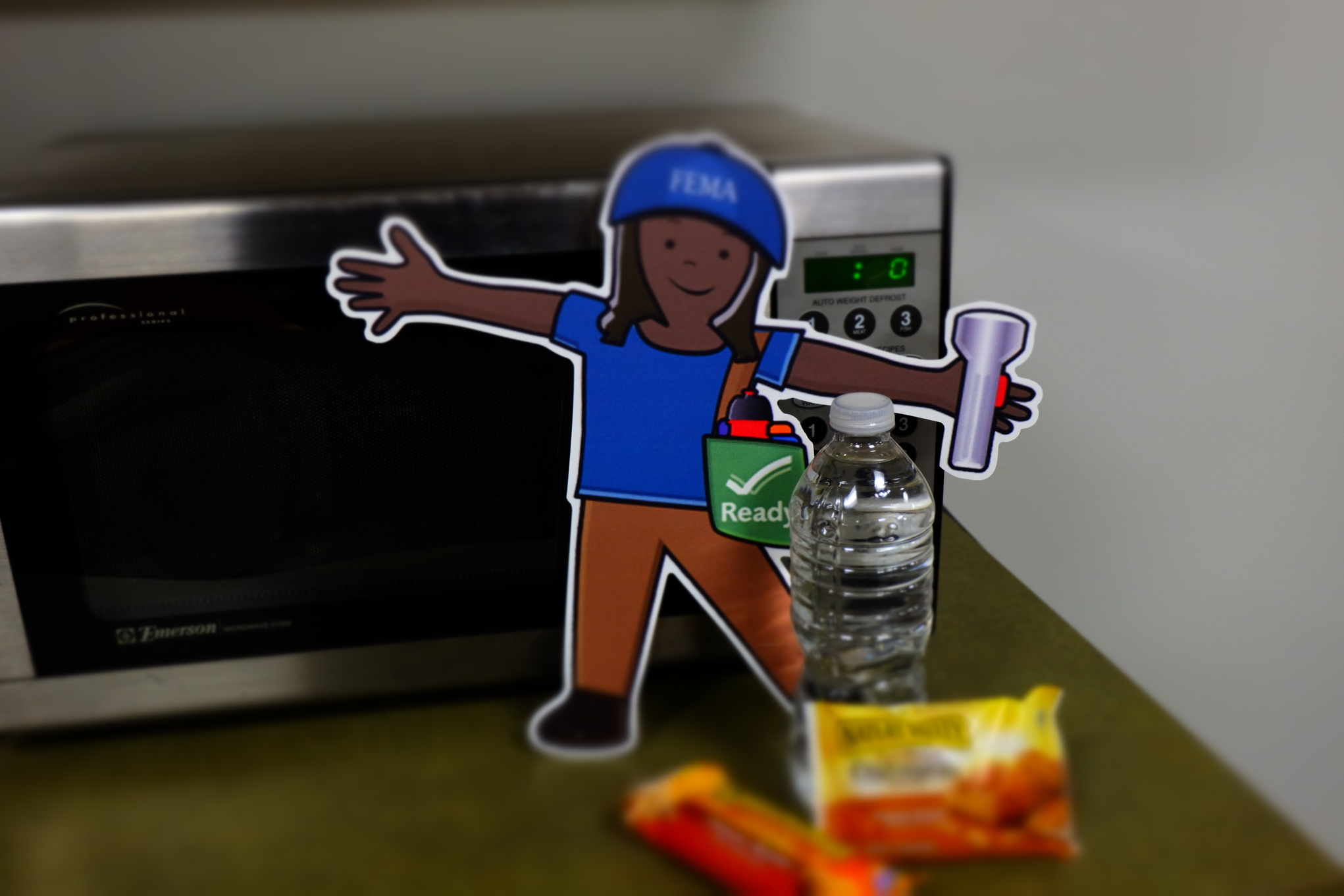 Washington, D.C., October 30, 2013 -- Flat Stella shows some other items to include in your emergency supply kit. Water and snacks should be included in your kit.