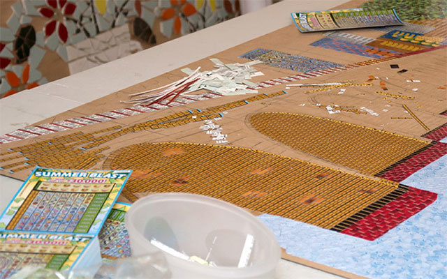 A sneak peek of the mosaic made of lottery tickets inspired by the Stone Arch Bridge.