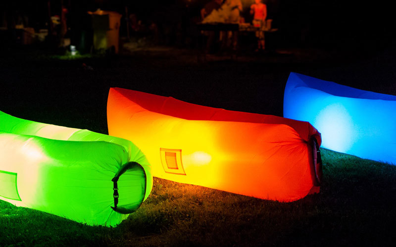 Inflatable seats lit up in the night