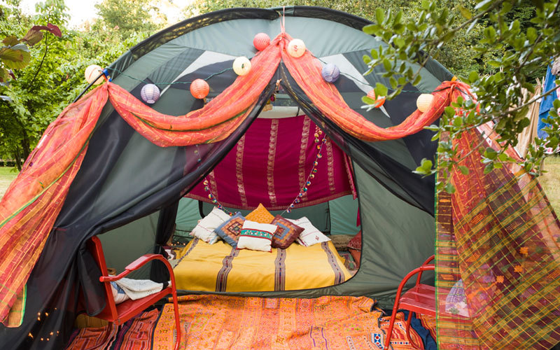 Glamorous camp site with pillows and rugs