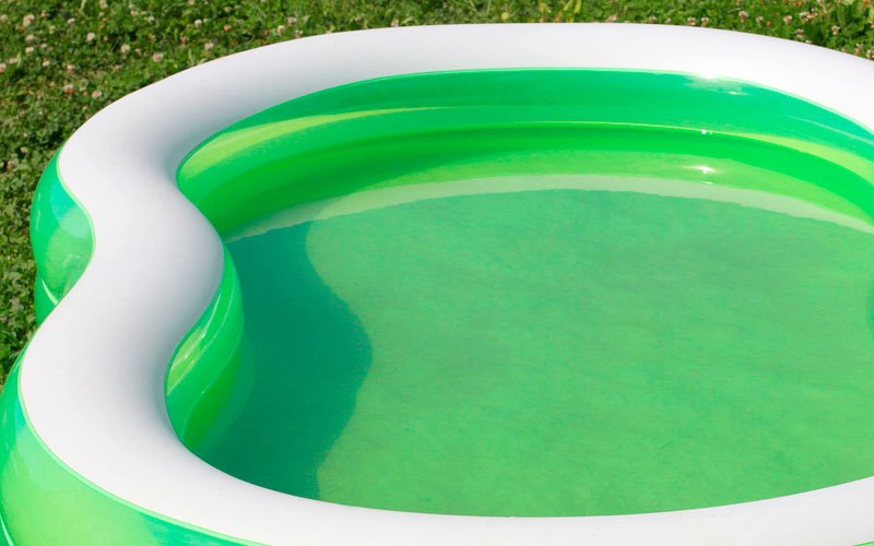 Inflatable pool filled with water on the grass